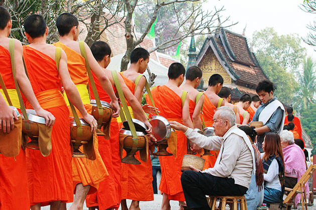 alms giving - luxury asia travel guide